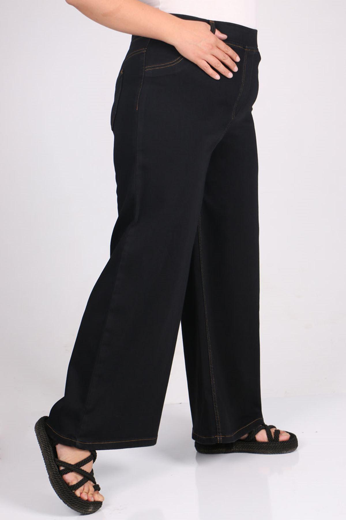 9142 بنطلون جينز مرن الخصر و واسع الساق و مقاس كبير  - أزرق داكن