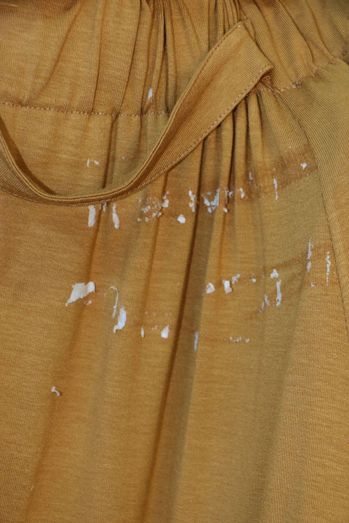 5046  تنورة  مقاس كبير بخصر مرن و بأزرار - زعفران